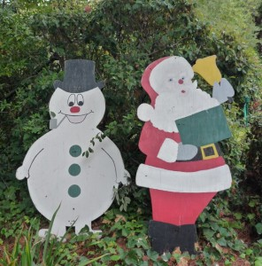 Some holiday decor has stood the test of time, like this old school Frosty and Santa next to a hedge on Bay Laurel.