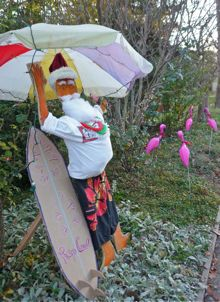 Post image for Surfin' Santa led by pink flamingos