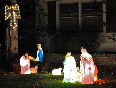 Three Wise Men approach the manger at Nativity scene on Cotton St. in Menlo Park