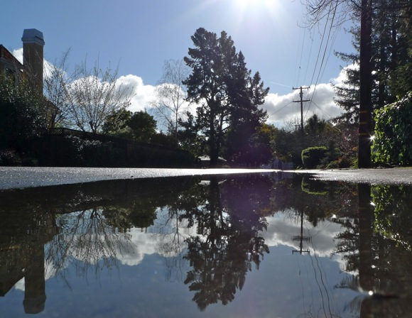 Post image for After the rains – blue sky, clouds and one big Menlo puddle