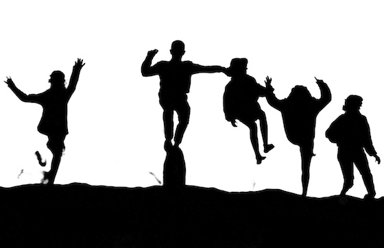 Marc Silber photo of children jumping from sand dunes