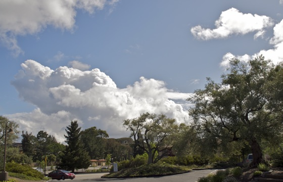 Post image for Cold rain blows through Menlo, puffy white clouds follow