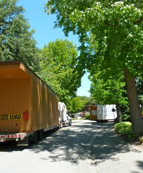 Portable classrooms from Oak Knoll School get wheeled away