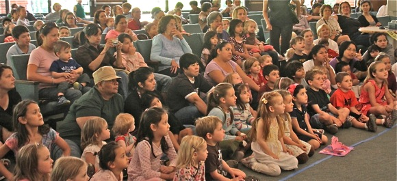Children and parents watch Shadow Puppet Workshop at Menlo Park City Council Chambers