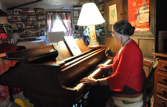 Nan Bostick playing ragtime piano in her Menlo Park home