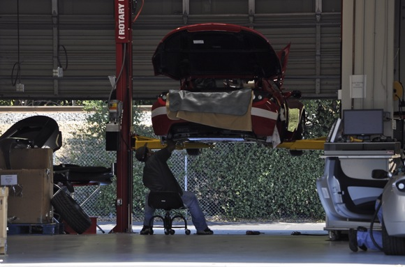 Worker assembles Tesla roadster in the company's Menlo Park, CA facility
