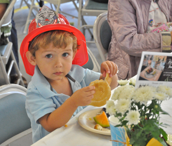Pancake eating kid at 10th annual pancake breakfast at fire house in Menlo Park, CA