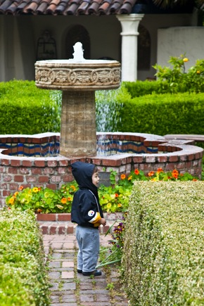 Child in the gardens of Allied Arts Guild in Menlo Park