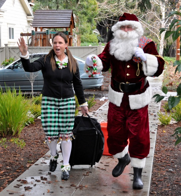 Santa and elf at holiday party in Menlo Park
