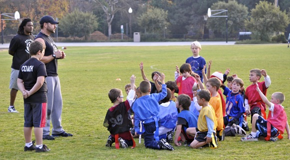 Coach Lawrence McNeil with flag football participants