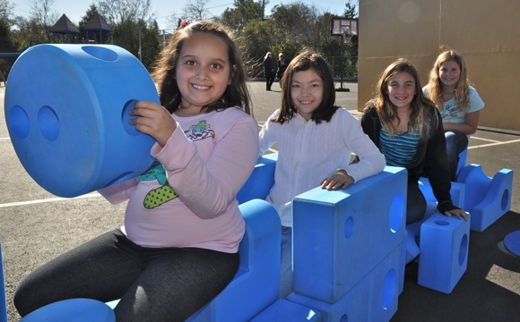 Oak Knoll students playing with Imagination Playground equipment