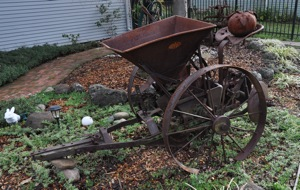 antique potato planter in Menlo Park CA frontyard