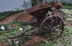 antique potato planter in Menlo Park CA frontyard