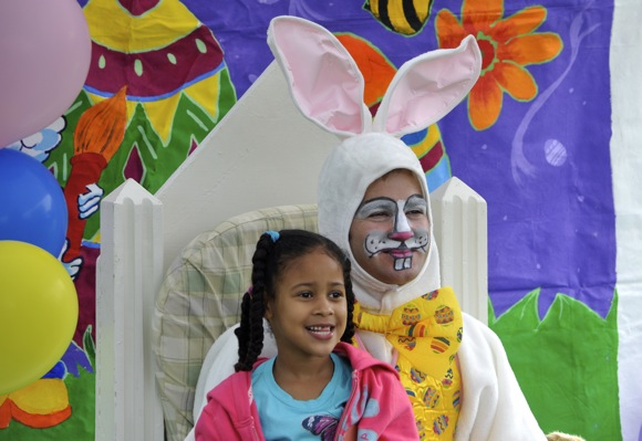 girl with Easter bunny at City of Menlo Park's festivities