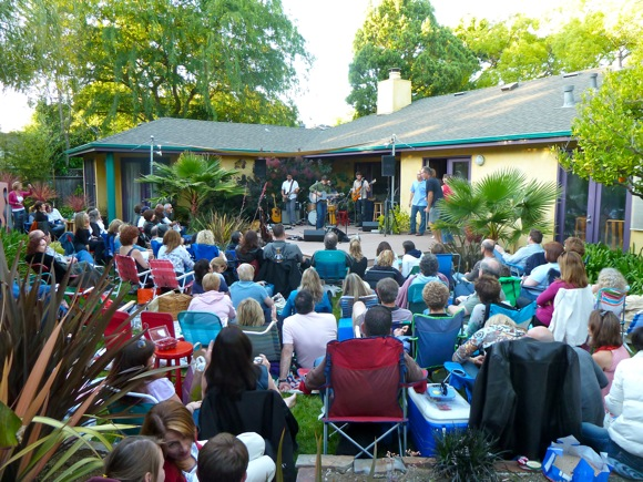Luce performing at Blue Rock House Concert in 2011