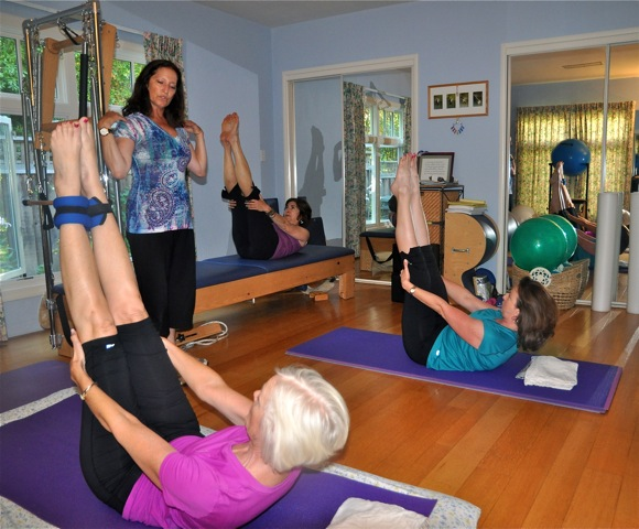 Lisa Burnett teaching Pilates class