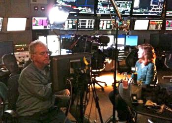 SLAC physicist JoAnne Hewett being interviewed for Discovery Channel show