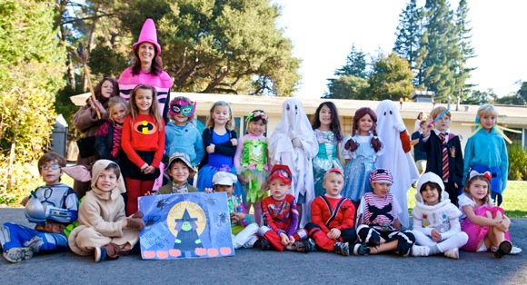 youngsters with Halloween costumed classmates