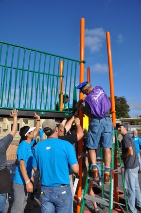 Volunteers build new playground at Willow Oaks