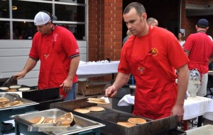 fire fighters flipping pancakes