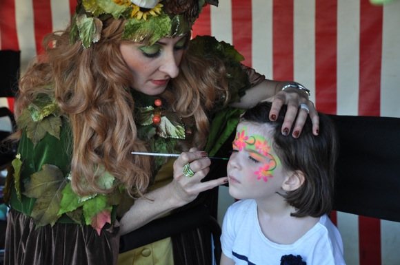 Girl getting her face painted at St. Raymond Pumpkin Festival