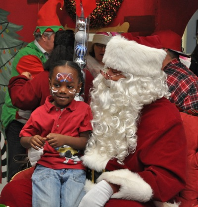 young girl visits with Santa at JobTrain holiday party
