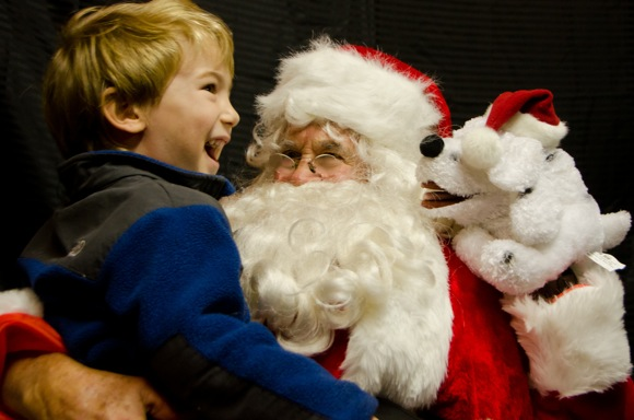 Santa and child at Salvatierra neighborhood party