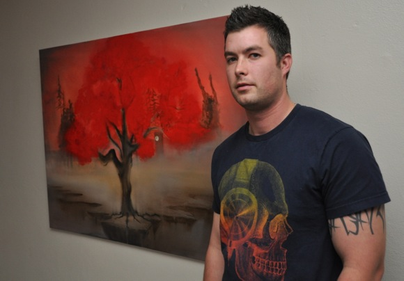 Artist Aaron Molinsky with his painting from Menlo College Plein Art Show