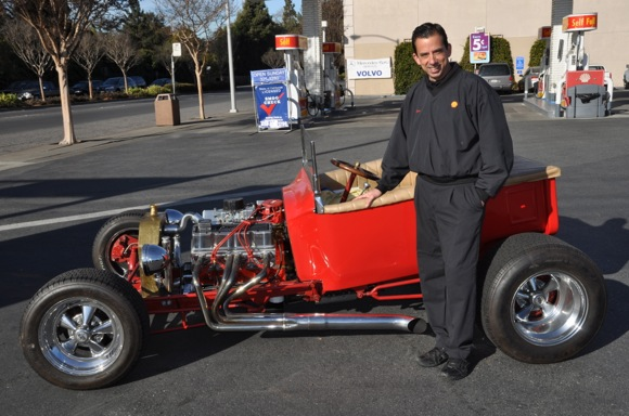Dan Bajada, owner of Menlo-Atherton Shell with hot rod