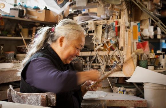Joy Imai working at her studio in Menlo Park