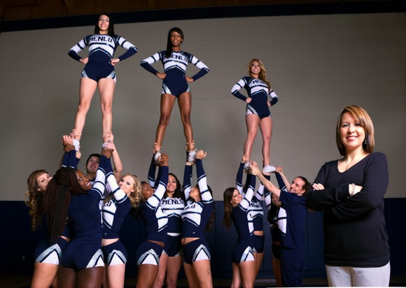 Kezia Molinsky, head competitive cheer coach at Menlo College with her team