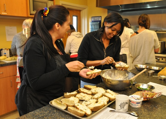 Stanford Park nannies making twice baked potatoes at cooking class taught by Chef Suzy