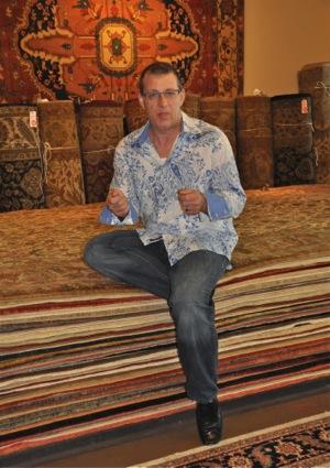 Bruce Good raffles off carpet for charity