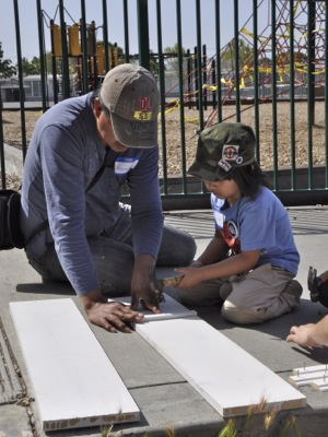 Project Read-Menlo Park partipates in Compassion Weekend by building bookcases