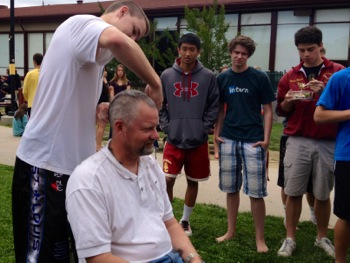 M-A lacrosse coach gets his head shave post league victory