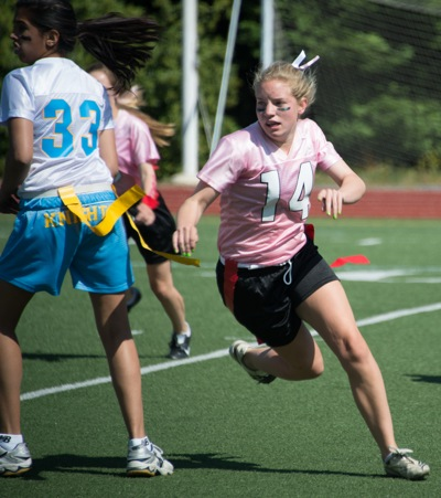8th grade girls mix it up in powderpuff football game