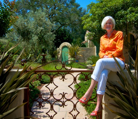 Carol Mince in the side gate of her Menlo Park home