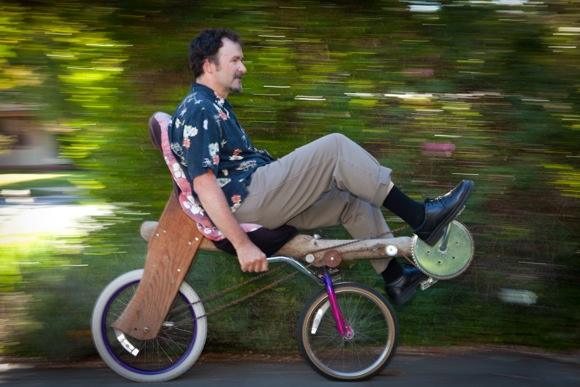 Tom Kabat on one of his wooden bikes