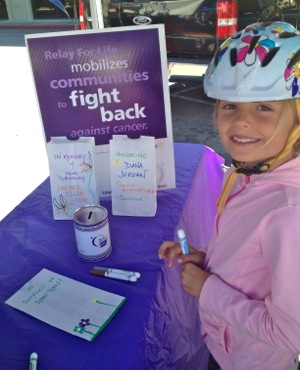 young girl making luminaries for Relay for Life of Menlo Park