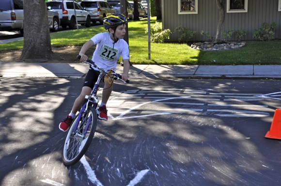 Kids Triathlon cyclist making the turn in Menlo Park