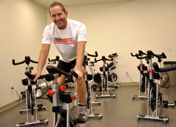 Bill Kirsch teaches spinning class at Menlo Swim and Sport in Menlo Park