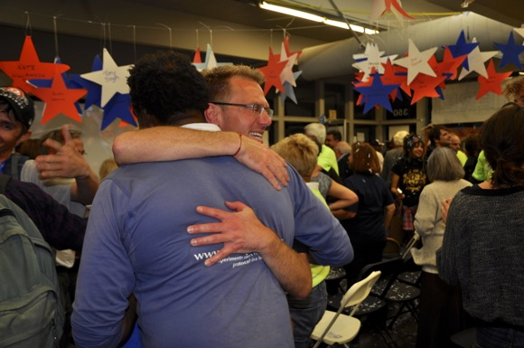 victory hugs at Democratic headquarters after Obama is reelected