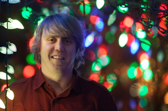 David Barshow surrounded by Christmas lights at Menlo Park Presbyterian Church