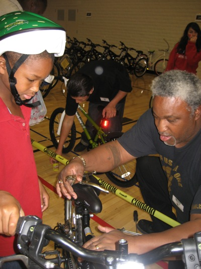 Jerry Elster adjusts bike at 13th annual Community Giveback