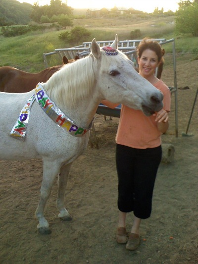 """Wilson Farrar says """"Happy Birthday"""" to her horse, Scooter, with a party"""