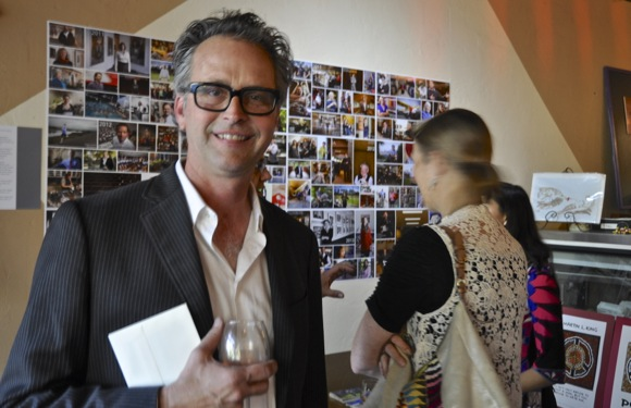 Photographer Scott Kline at opening reception of his photo exhibit at Cafe Zoe in Menlo Park