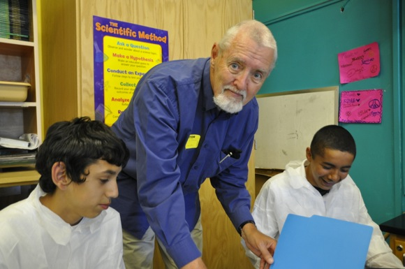 Skip Bond conducts science lab at Belle Haven School in Menlo Park