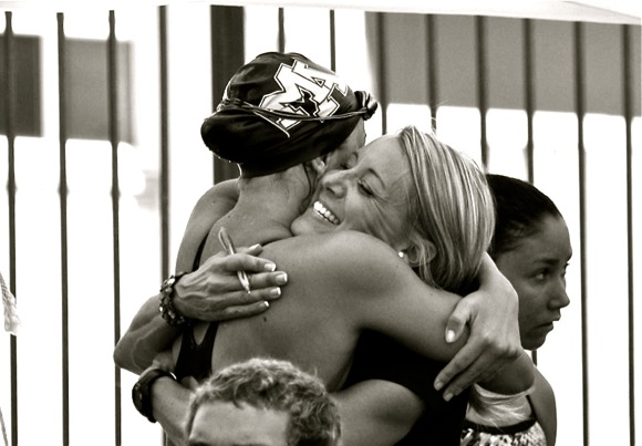 M-A swimming coach Lori Stenstrom gives daughter Brooke a congratulatory hug