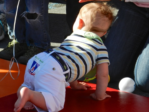 Baby participating in Diaper Derby at downtown Menlo Park block party