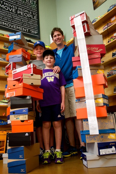 Fleet Feet Menlo Park and family with shoe contributions with employee